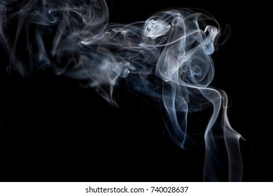 Movement of abstract smoke isolated on black background.
