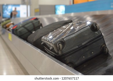 The movement of baggage on a conveyor belt