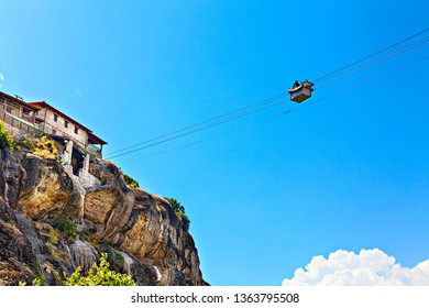 Movement between the rock monasteries on the cable car. Greece, Europe.