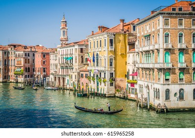 The movement of boats along the grand canal in Venice on a sunny May day