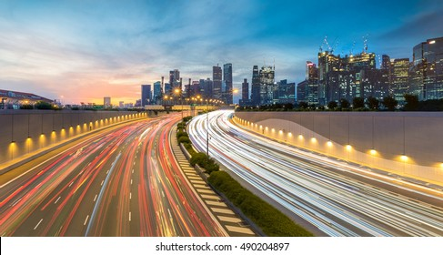 Movement of car light with Singapore cityscape skyline during sunset