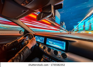 Movement of the car at night at high speed view from the interior with driver hands on wheel. Concept spped of life. - Shutterstock ID 1735582352