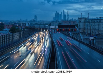 Movement of cars along the avenue in Moscow at night