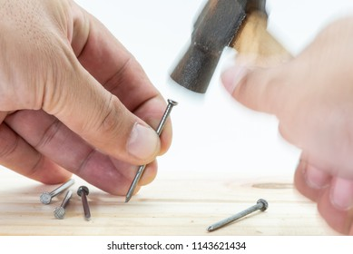 Movement of hands hitting a nail by hammer isolatedon white background