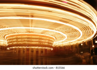 Movement of lights on a carousel ride.