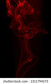 Movement of red smoke on black background