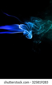 movement of smoke, Abstract Light blue smoke on black background, Light blue background,Light blue ink background