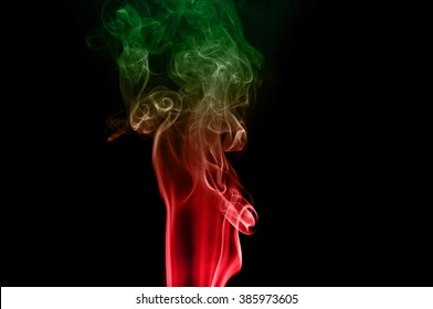 movement of smoke red and green on black background ink beautiful