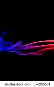 Movement of smoke,Red and blue smoke swirl on black background, Color smoke on black background