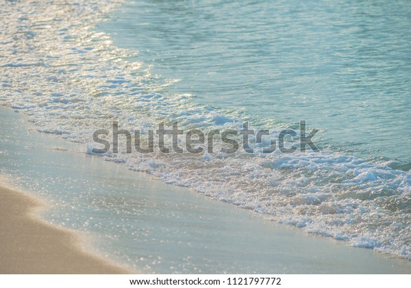Movement of Soft Blue Ocean beach wave of the sea on the sand