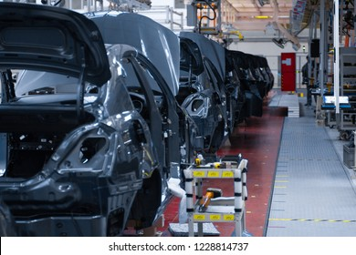 Movement of vehicles along the production line at the plant. Car Assembly shop. Car Assembly by parts
