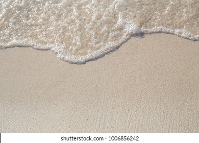 The movement of the waves on the sand is smooth and fine for  background,Soft focus