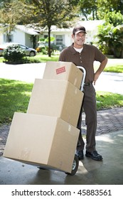 Mover or delivery man arrives with a stack of boxes for you.