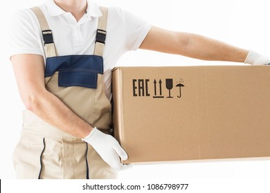 Mover holding in hands cardboard box isolated on white background. Relocation services concept. Loader in uniform with box. Worker in gloves with box for moving