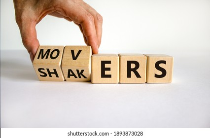 Movers and Shakers symbol. Businessman hand turns cubes and changes the word 'shakers' to 'movers'. Beautiful white background. Business and Movers and Shakers concept. Copy space.