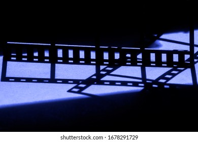 Movie background.Film reel stripe cinema on blue and black background with place for text
