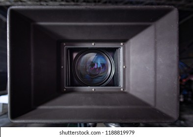Movie camera lens and sunshade in a studio