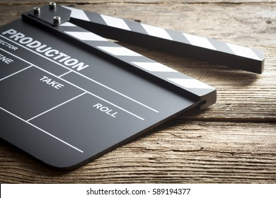 Movie clapper board on old wooden background