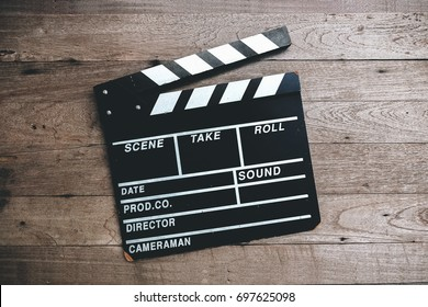 Movie clapper board on a vintage wooden background, Slate film movie production