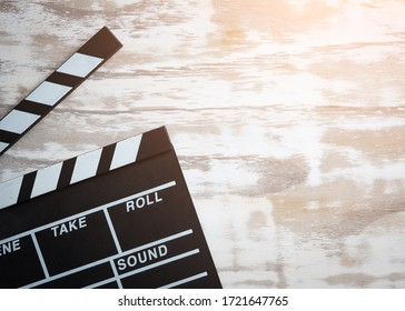 Movie clapper board on wooden table background,top view
