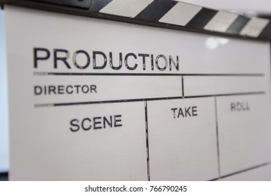Movie clapper and editing room in background, cinema concept