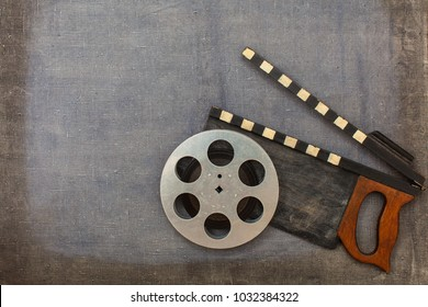 Movie clapper and film reel on the painted background