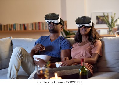 movie experience date night couple at home with VR goggles