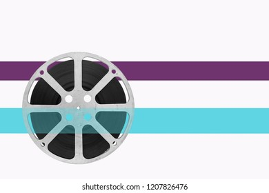 movie film reel with colour tape for text