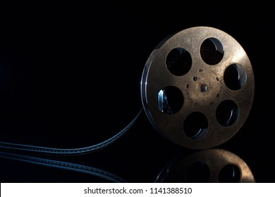 movie film reel on a black background with shadow