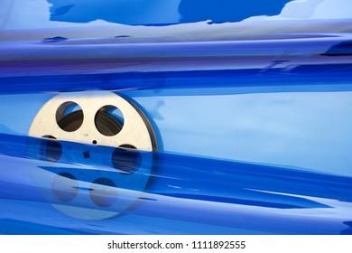 Movie film reel on blue