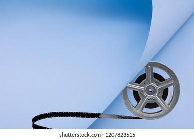 movie film reel on blue background