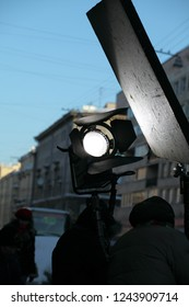 Movie light on the background of the reflector on the film shooting