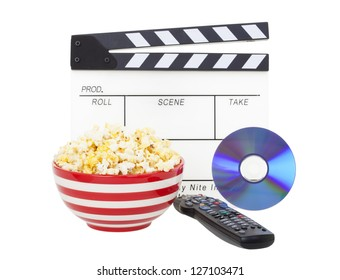 Movie night theme.  A bowl of fresh popcorn, with clapper board, movie and television remote.  Shot on white background.