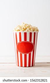 Movie Popcorn in bucket on wood background