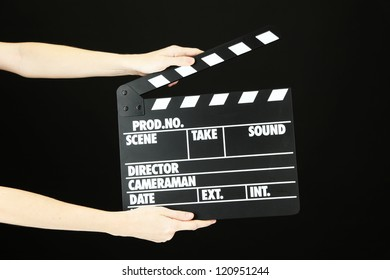 Movie production clapper board isolated on black