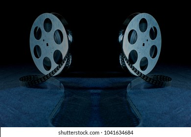 Movie reel on a black background with shadow