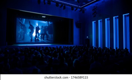In Movie Theater Captivated Audience Watching New Blockbuster Film with Military Soldiers.