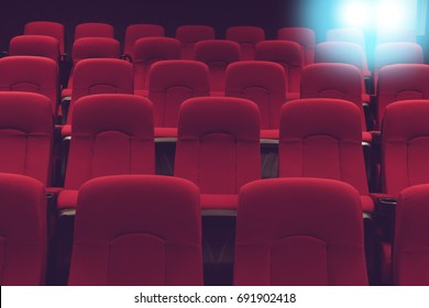 movie theater empty auditorium with red seats and blue lighting