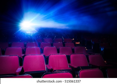 Movie Theater with empty seats and projector / High contrast image