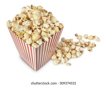 A movie theater popcorn box heaped with the fresh popped, crispy, salty, buttered snack.