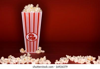 Movie theme popcorn box on red background