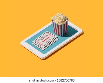 Movie ticket booking app: popcorn and movie theater tickets on a smartphone