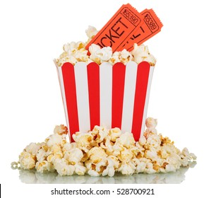 Movie tickets, big striped box and spilled popcorn isolated on white background