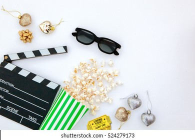 movie tickets, clapperboard, pop corn and 3d glasses in a white background..Flat lay .Christmas concept