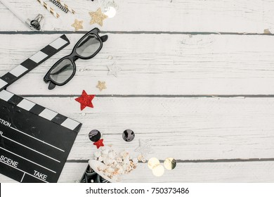 movie tickets, clapperboard, pop corn and 3d glasses in a white background..Flat lay .party concept