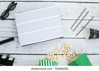 movie tickets, clapperboard, pop corn and 3d glasses in a white background..Flat lay .Black lightbox