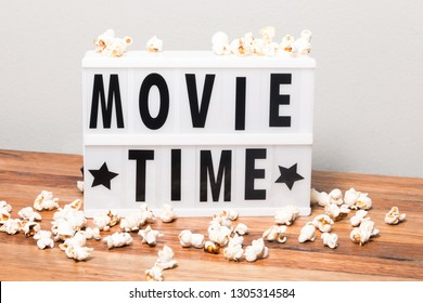 Movie time text in lightbox with popcorns