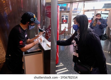 Moviegoers scan their tickets at the AMC Theater on the first day of reopened theaters after being closed due to the COVID-19 pandemic in Burbank, California, on March 15, 2021.