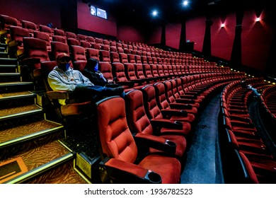 Moviegoers sitting in a socially distant seating arrangement at the AMC Theater on the first day of reopened theaters after being closed due to the COVID-19 in Burbank, Calif., on March 1, 2021.