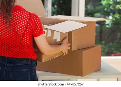 Moving box. Women carrying box